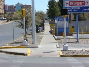 Photo showing APS on a corner on separated poles, each one on the side of the crosswalk furthest from the intersection